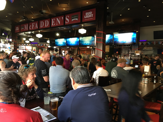 Fans crowd McFadden's Restaurant and Saloon in Glendale