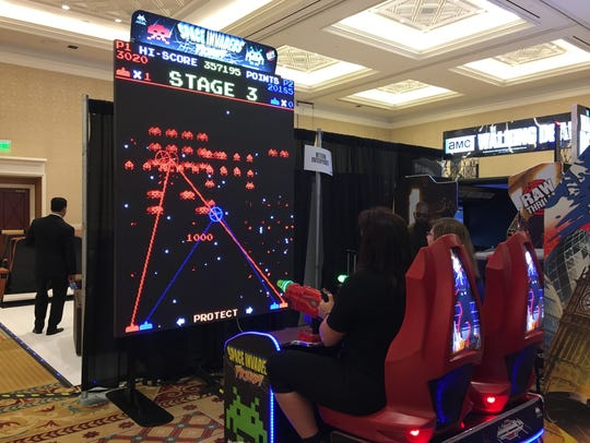 Mowing down aliens in Space Invaders Frenzy at CinemaCon.