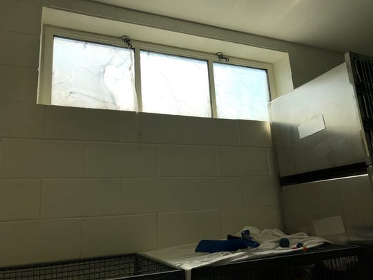 A window damaged in the fire awaits repair in one of the second-floor rooms.