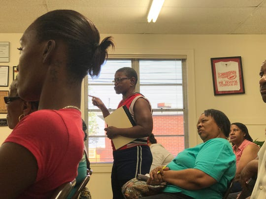 Lecompte resident Katherleen Smith speaks during a