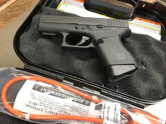 A 9 mm handgun on display at Smith's Guns on Alameda Street. All guns sold at the store come with a lock, or a lock is offered in case a used gun does not have one. A handgun safety booklet is also provided to anyone who purchases a gun.