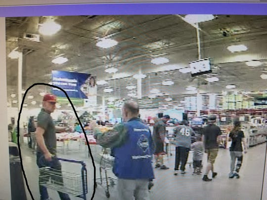 Officers are seeking information about a male suspect, circled, who has allegedly stolen electronics from the Sam's Club in Farmington.