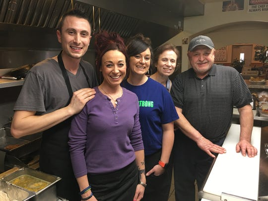 Members of the Alimi family are shown in their restaurant, Paradise Bar & Grill in Plover. They are, from left, Adrian, Suzana, Lulu, Sherri and Matt.