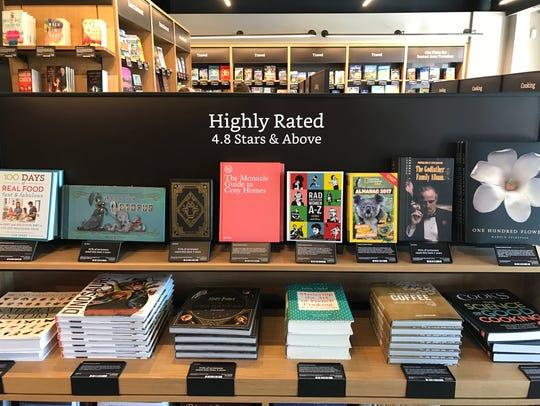 The Amazon Books store in Dedham, Mass., displays books
