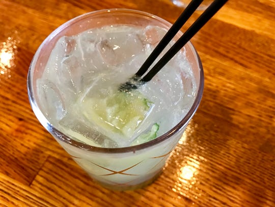 A freshly shaken caipirinha from the full bar at Che
