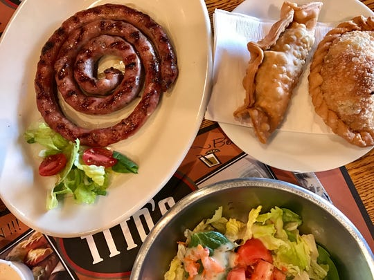 Salchichas, empanadas and a salad from Che Tito's Steakhouse