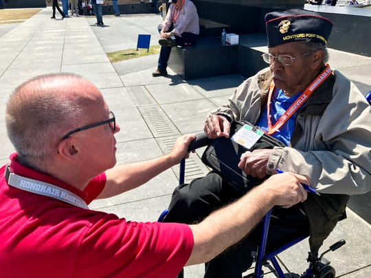 Eddie Mannis, fhairman and founder of HonorAir Knoxville, talks with World War II veteran Albert Winton Sr. of Roane County at the Air Force Memorial during the HonorAir Knoxville trip to Washington, D.C., on Wednesday, April 5, 2017.
