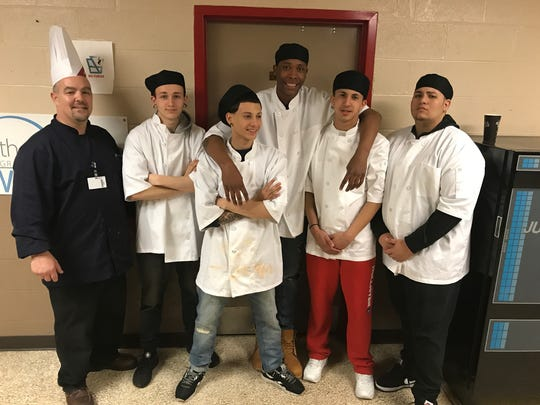 Gathered for a group shot, Chef Trevor Sipe, and Youth Advocate Program participants Logan Shearer, Julian Hernandez, Tyshon Staten, Emanuel Rodriguez and Jean Morales.