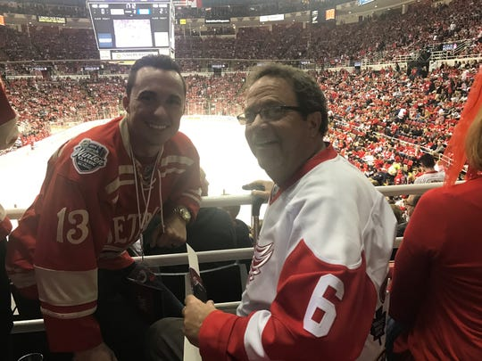 Bobby Clemens, left, and his father, Rob Clemens, attend Sunday's Red Wings finale at Joe Louis Arena.