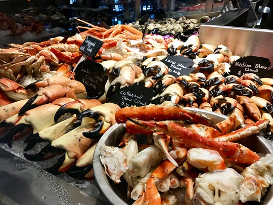 Stone crab claws mingle with other crabs in the seafood case at Lobster Lady.