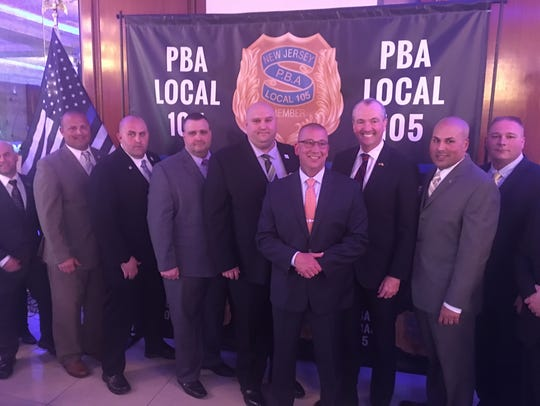 PBA Local 105 President Brian Renshaw and his Executive Board endorsed Phil Murphy for governor in April 2017. Murphy is standing third from right; Renshaw is to his left.
