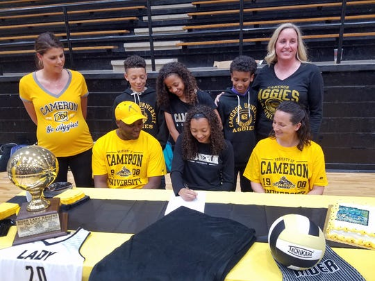 Rider senior Jazmin Luster will double dip at Cameron after signing a letter of intent to play volleyball and basketball Monday.