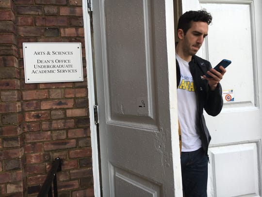 A University of Delaware student leaves the College