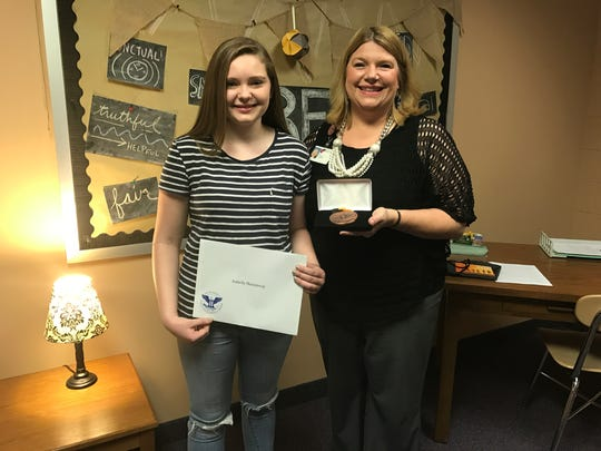 Izzy Hemenway, 13, of Boonville was named a Distinguished Finalist for Indiana in the 2017 Prudential Spirit of Community Awards. She received a bronze medallion Tuesday.
