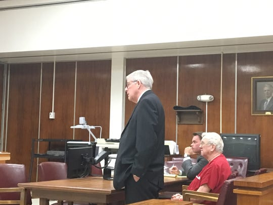 Attorney Bo Reed, standing, who represents Lee Howard Cromwell in four lawsuits filed against him seeking monetary damages for his July 4, 2015, rampage in a parking lot that killed one man and injured 11 others, makes a point with appointed Circuit Judge John D. McAfee during an April 12 hearing in Anderson County Circuit Court. Cromwell is seated while shackled at the ankles and wrists. At far right is attorney Jason Fisher, who represents State Farm Insurance Co.