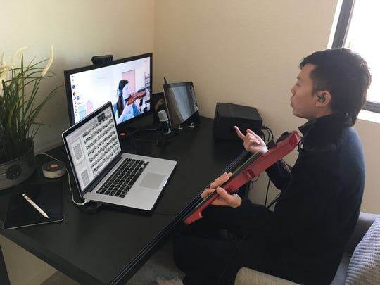 Jason Yang, a violinist and composer who runs a popular YouTube channel, live-streams lessons and seminars to students around the world.