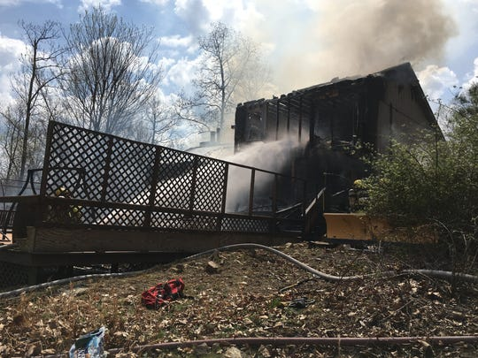 Firefighters tamp down a fire in Lyndhurst that destroyed a home on Thursday, April 13, 2017.