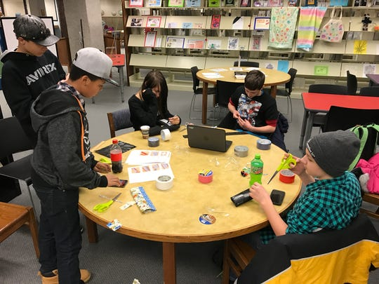 Area teens made wallets, bags and other crafts using duct tape during a recent visit to the Imaginarium at Mead Public Library.