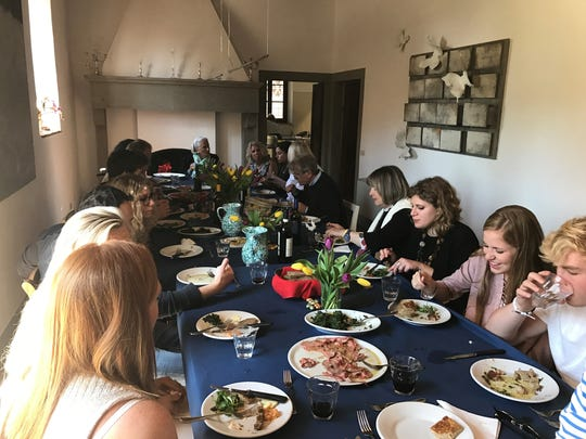 Guests eat a multi-course Italian Easter feast in Tuscany.