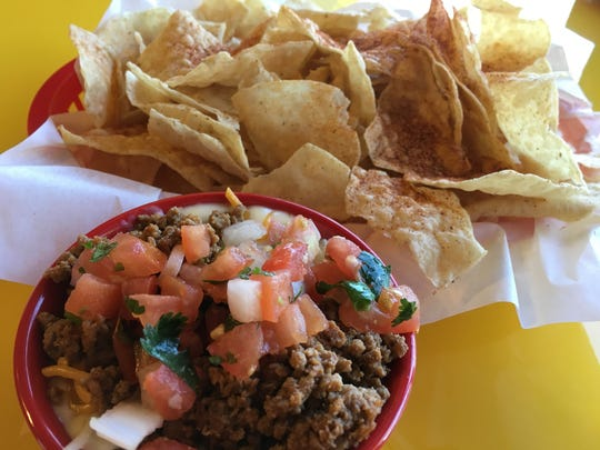The chips and queso with beef costs $4.79 at the new Fuzzy's Taco Shop in North Naples.