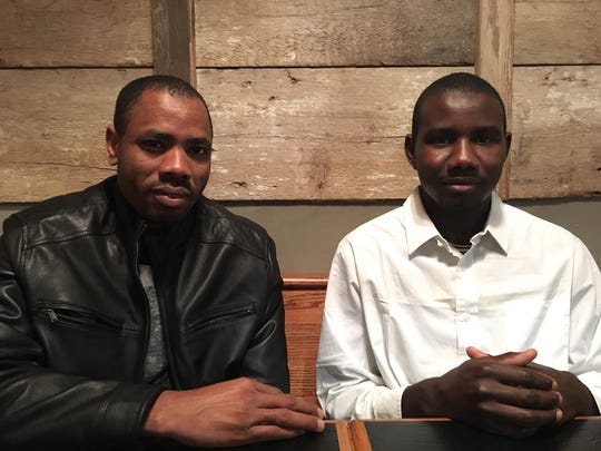 Mohamed Taha Mohamed (left) and Abdelrahman Abshir, refugees from Darfur in Sudan, are photographed at the French Press in Waynesboro, Va., where they recently resettled in 2017.
