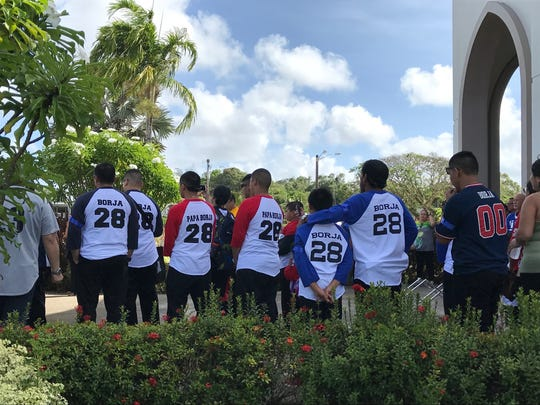 Family and friends don the no. 28 on baseball tees