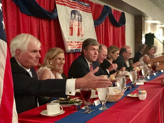 U.S. Rep. John J. Duncan Jr. reaches to shake someone's hand during Friday night's Knox County Republican Party's Lincoln Day Dinner..