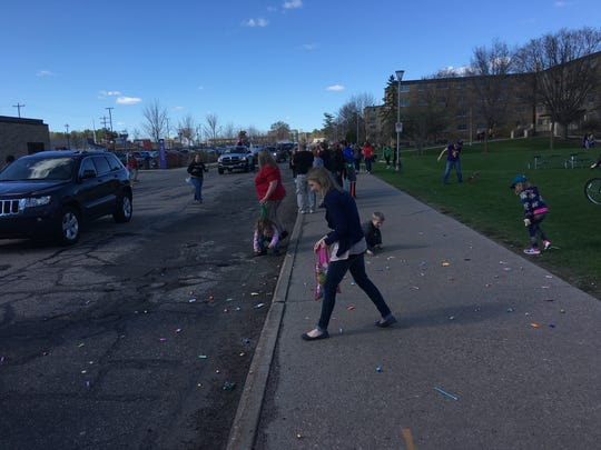 Children run after candy during the Trivia Parade, held on the University of Wisconsin-Stevens Point campus on April 21, 2017.