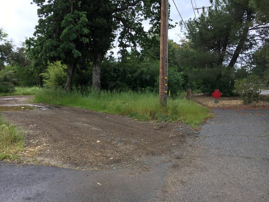 A dirt road to the south of the neighborhood connects