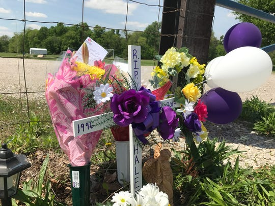 A memorial in honor of Halee Rathgeber on an afternoon in April 2017 near where the 20-year-old woman's body was found.