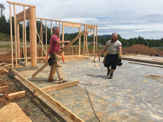 Aaron Jones, owner of Jones Construction, and Adam Bright, right, work on a house in Deer Creek Manor in Shasta Lake on Tuesday.
