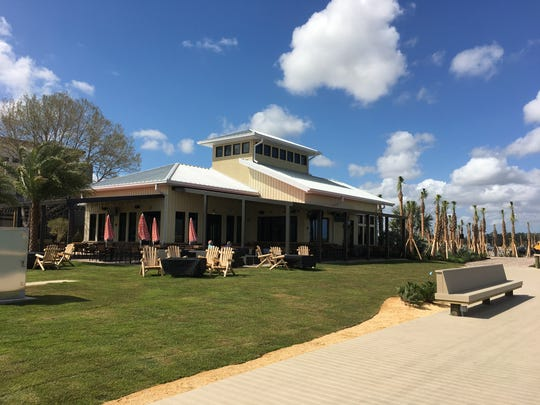 Located on the boardwalk along the edge of Lake Babcock, Table & Tap was the first building to be completed at Founder's Square.