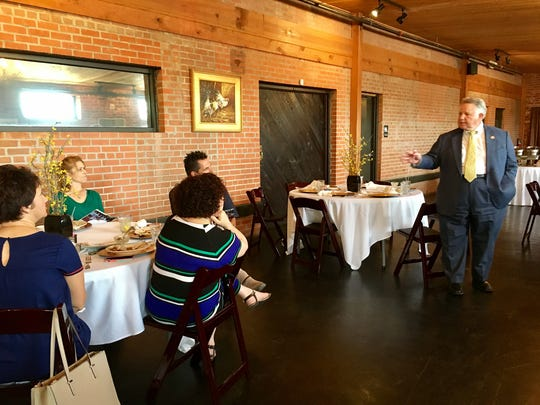 """David """"Buck"""" Landry, president of the University of Holy Cross in New Orleans, talks with officials from Diocese of Lafayette schools Wednesday."""