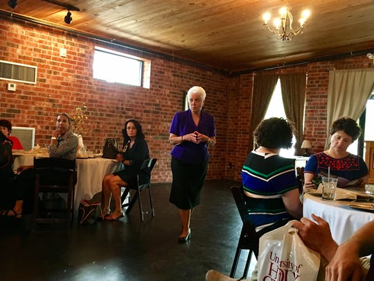 Anna Larriviere, superintendent of Catholic schools in the Diocese of Lafayette, speaks with officials from her schools and the University of Holy Cross on Wednesday.
