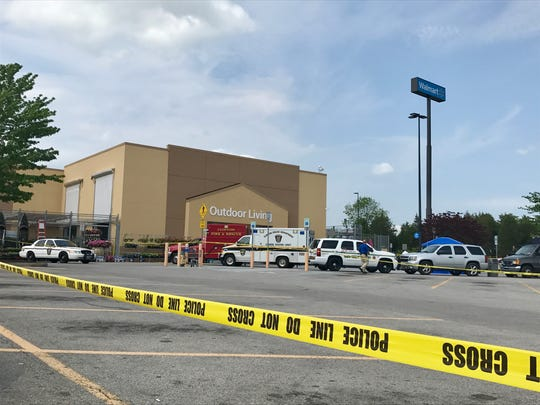 Clinton police, with assistance from the Anderson County Sheriff's Office, investigate a 2 p.m. Friday shooting outside a Walmart that left one male dead.