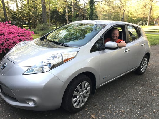 DelmarvaNow reporter Jeremy Cox poses in his 2013 Nissan Leaf.