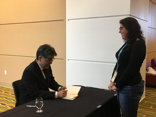 Katie Edwards, sophomore at the University of Wisconsin-Green Bay, talks with author Sherman Alexie during Sunday's book signing. The events was part of the UntitledTown book and author festival.