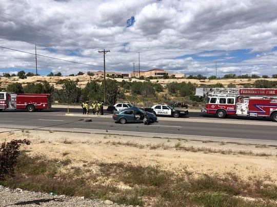 Police investigate a fatal crash on Piñon Hills Boulevard in Farmington Monday.