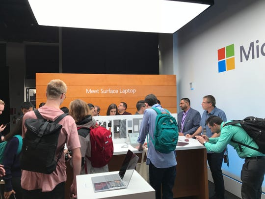 Crowding around Surface Laptop at Microsoft's education-focused