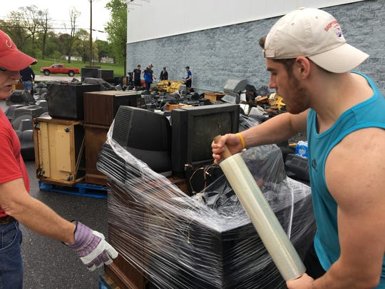 Shippensburg University volunteers helped pack 10 tractor-trailer loads of old televisions and other electronics after Ship Shape Day in 2017.
