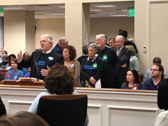 Opponents of short-term rentals, led by John Summers, a former councilman and a member of the Nashville Neighborhood Alliance, attend a public hearing.