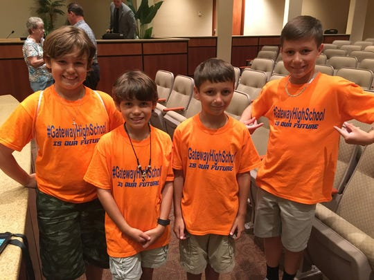 "Children who live in Gateway wore bright orange shirts that read ""Gateway High School is our future"" to the Site Selection Committee meeting."