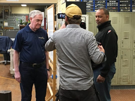 """Richard Shine, left, is filmed for the IBEW """"Hour Power"""" in his classroom on the MCVTS East Brunswick Campus."""