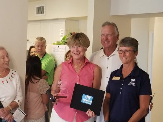 Susan Mulligan, left, and her husband Terry Mulligan paid $50,000 to sponsor construction of the Leonard home through Habitat for Humanity.