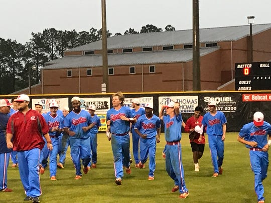 The Pine Forest baseball team celebrates their 5-2 win against Pace in Wednesday night's District 1-7A Tournament semifinal game at Tate, prior to the deluge of bad weather. The Eagles play the winner of Tate-Escambia on Friday night at 7 p.m. for the district championship.