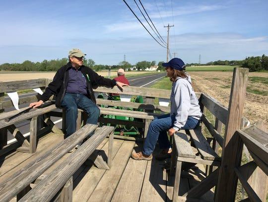 NJ Secretary of Agriculture Doug Fisher (left) rides