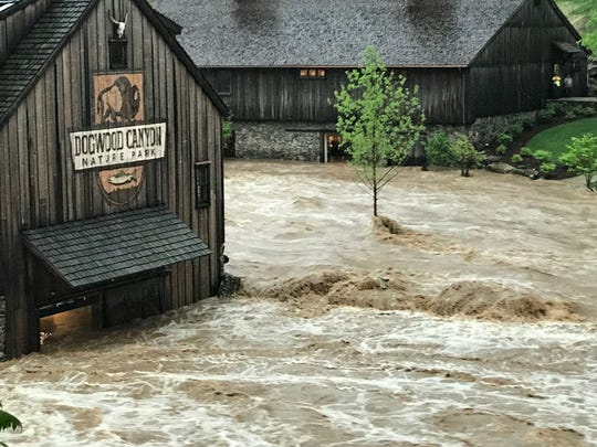 Raging floodwater from Little Indian Creek pushes