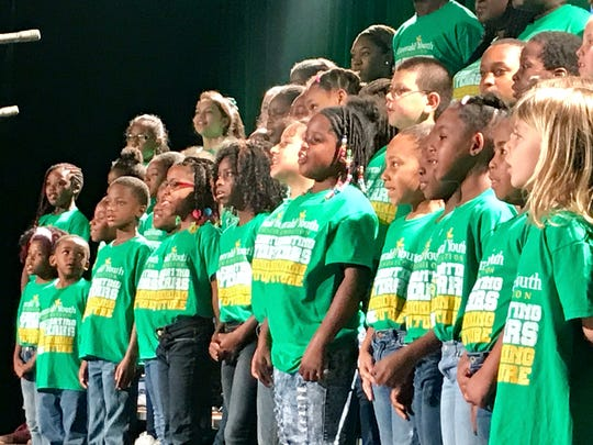 Children from the Emerald Youth Foundation sing during 2017's 25th anniversary breakfast.