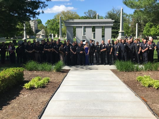 Police officers and sheriff's deputies surprise Sierra Bradway for her prom photos. Her father, IMPD Officer Rod Bradway, was killed in the line of duty in 2013.