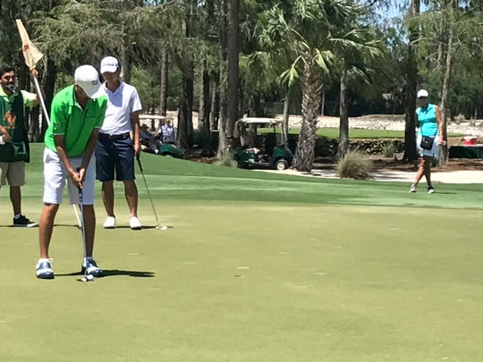Golfer Travis Trace of Jacksonville putts for par on No. 18 during the second round of the Terra Cotta Invitational at Naples National Golf Club on Saturday, May 6, 2017.